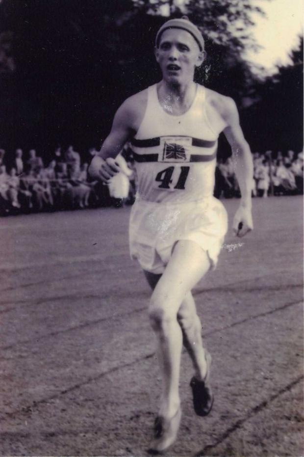 Running in his Olympic vest at an invitational race