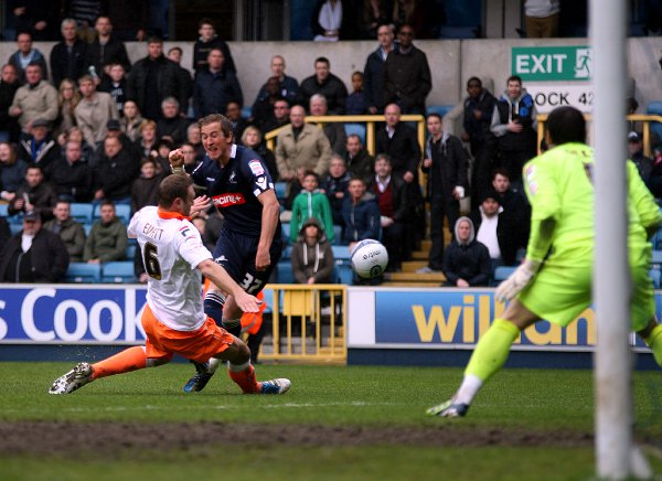 Ian Evatt blocks a Kane shot