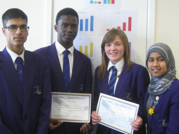 Business Academy Bexley maths pupils Naser Yasser, 16 (left), Dami Adegoke-Noel, 16, Patricia Wing, 16, Afsana Begum, 16.