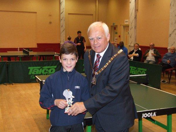 Robert Stewart is presented with one of his two trophies by the mayor