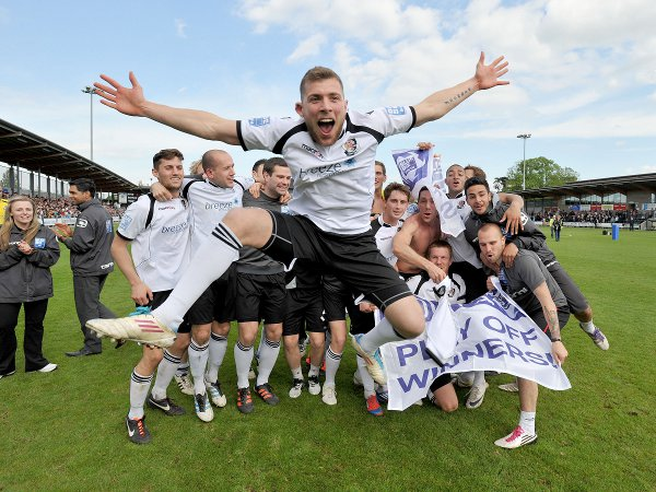 Ryan Hayes leaps for joy at the trophy presentation