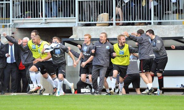 Tony Burman and his bench on the final whistle