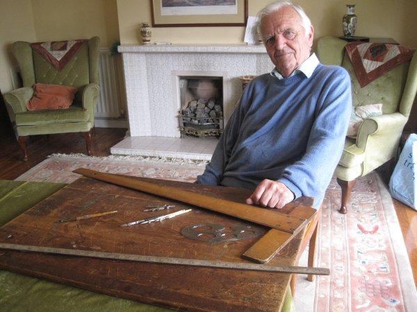 Alan Francis with the drawing board he planned the Queen's coronation on