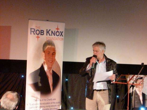 Rob Knox's father, Colin Knox, presents an award