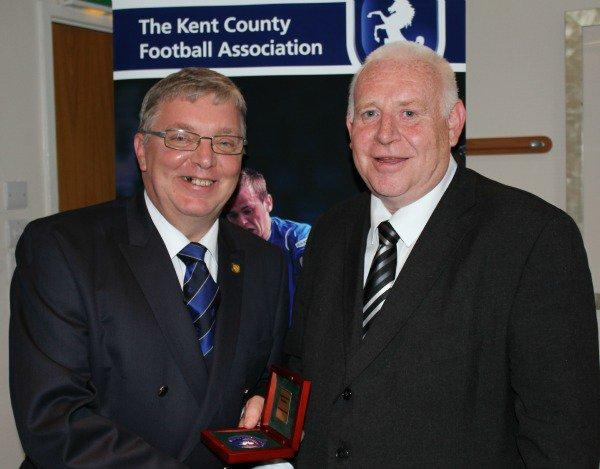 Kent FA Director Phil Smith (left) presenting the award to Ray Sampson-Chambers