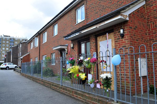 Floral tributes have been left outside Mr Green's flat in Holly Court.