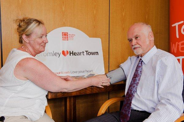 Cardiovascular nurse Tracy Ennis takes Councillor Graham Arthur's blood pressure