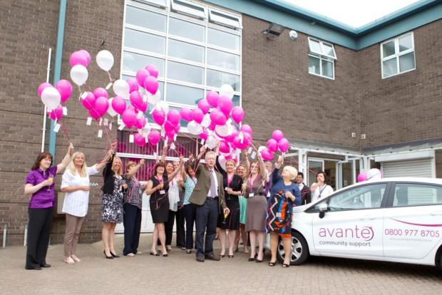 Care staff launch balloons to mark office opening