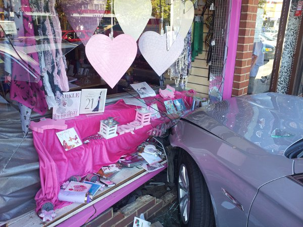 Shop sales down after car goes through window