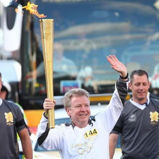 British Olympic Association chairman Colin Moynihan carried the Olympic Flame and has called for more Government funding for athletes