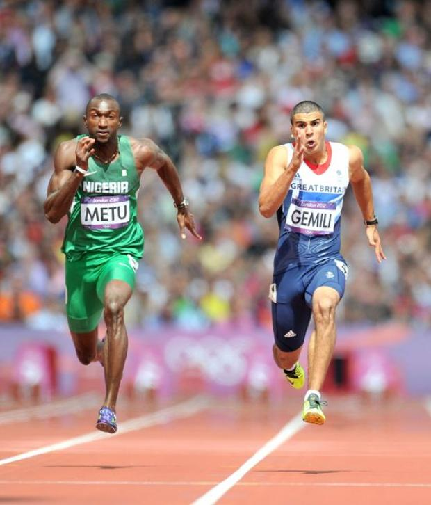 Adam Gemili competes with Obinna Metu Men's 100m heats at London 2012 (Picture by Martin Rickett/PA Wire)