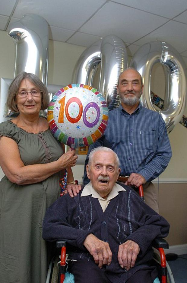 Daughter Dawn Fraser and son Mike Pallant with their 100-year-old dad Derek Pallant