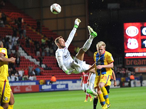 Ben Hamer tries an overhead kick after his initial header is cleared off the line