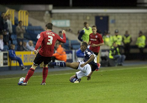 Jimmy Abdou tackles Andrew Taylor