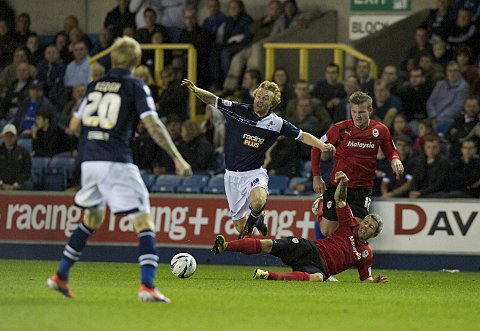 Chris Taylor is brought down by Kevin McNaughton