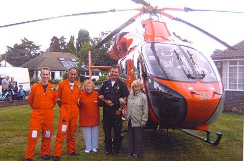 Air ambulance crew with the twins at their Marlings Park Avenue home