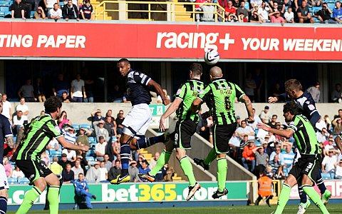 Liam Trotter challenges for a header