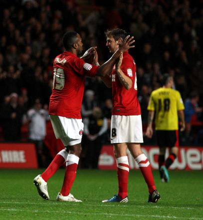 Dale Stephens congratulates Ricardo Fuller after he equalised against Watford last night. EDMUND BOYDEN.