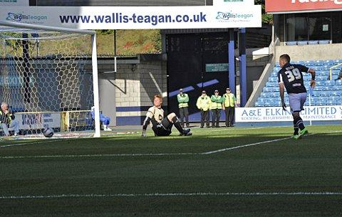 Bolton leeper Adam Bogdan is beaten by Darius Henderson's opener as Chris Wood looks on. PICTURES BY ALAN STANFORD.