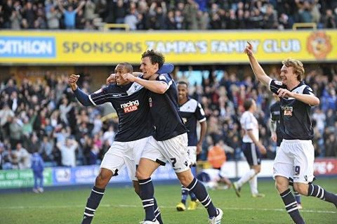 Darius Henderson celebrates his late winner with Shaun Batt. PICTURES BY ALAN STANFORD.