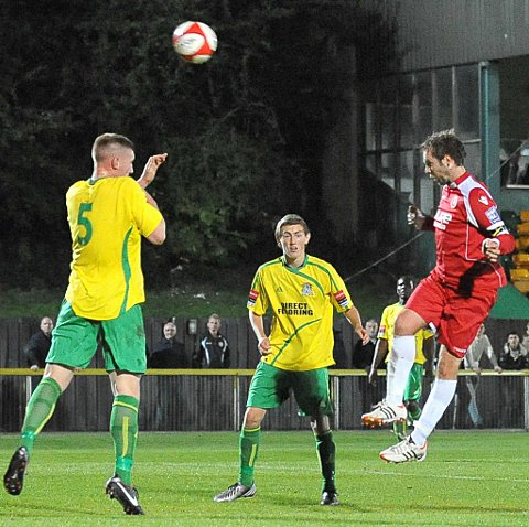 Lee Clarke (right) heads Welling's second goal over defender Matt Turpin