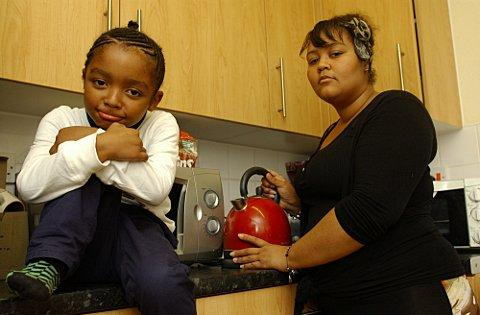 L-R Jazarni Hellis, 5, and Letoyah Hellis in their kitchen