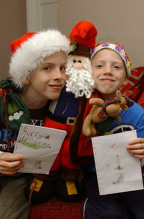 Ben Hurst, 10, and his brother Joe, 8, have got into the Christmas spirit by designing cards