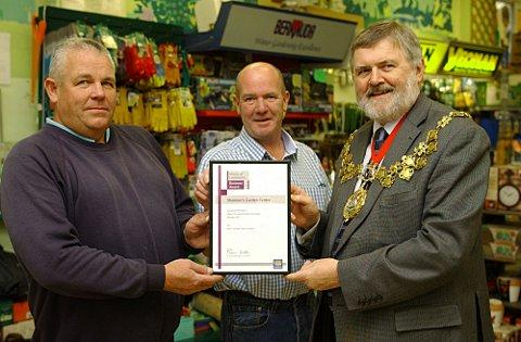 Mayor of Lewisham Sir Steve Bullock presents Bernard and Paul Shannon with the award
