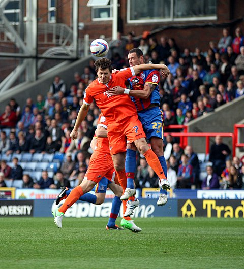 Darius Henderson and Damien Delaney battle for a header