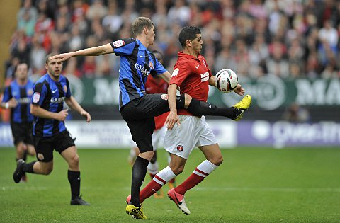 Salim Kerkar is challenged by John Stones