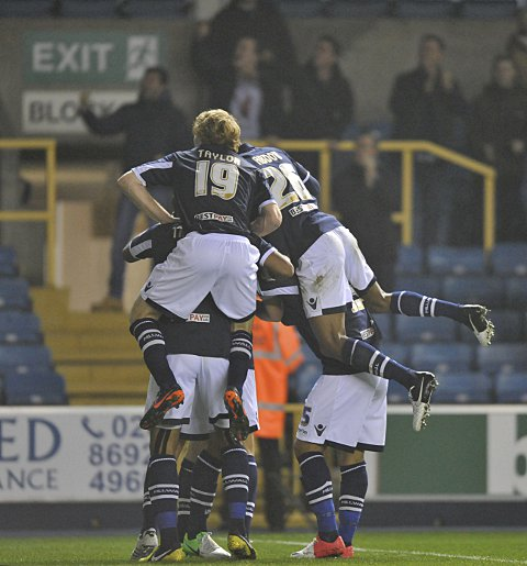Wood is mobbed by his Millwall team-mates