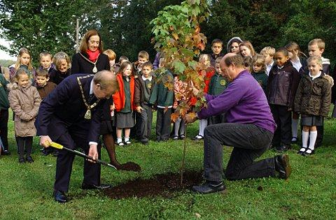 The celebratory tree is planted by the Mayor