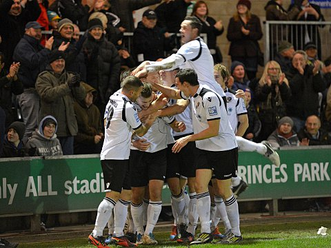 News Shopper: Hayes is mobbed after his goal