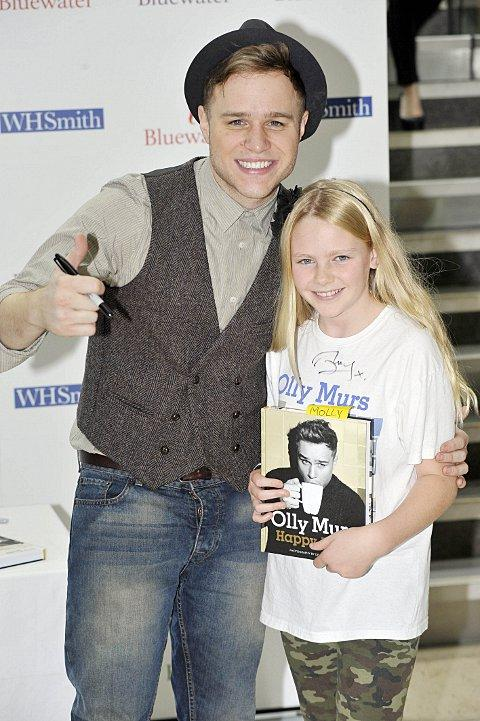 Olly Murs with an excited fan.