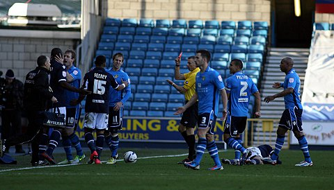 News Shopper: Luke Varney is sent off for his foul on Adam Smith