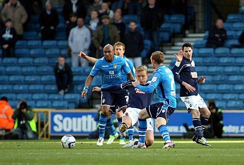 Josh Wright wins the ball against Leeds' Paul Green at The Den in November. PICTURE BY EDMUND BOYDEN.
