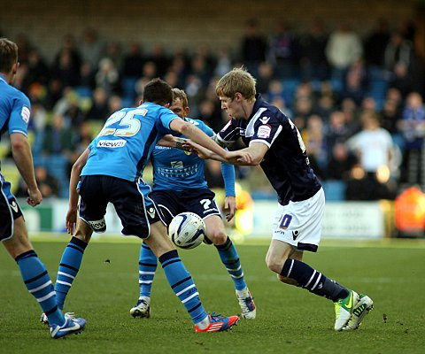 Andy Keogh takes on two Leeds defenders