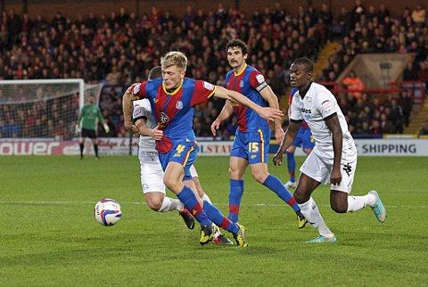 Jonathan Parr is pulled back by Derby's Paul Coutts as Palace go on the attack again in Saturday's 3-0 victory. PICTURE BY ALAN STANFORD.