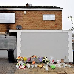 Floral tributes outside the home of Sabah Usmani in Barn Mead, Harlow, Essex