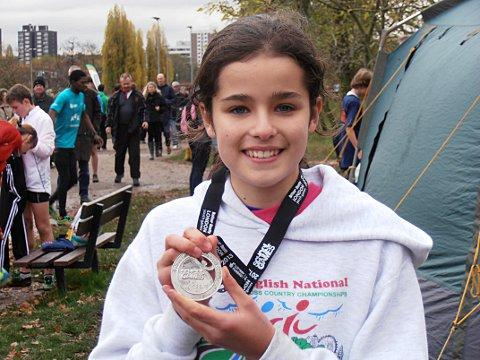 •	Holly Page won individual silver for the girls' U13 cross country event