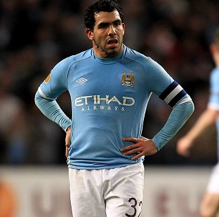 Manchester City's Carlos Tevez has received an interim ban from driving over failing to provide information when clocked for speeding