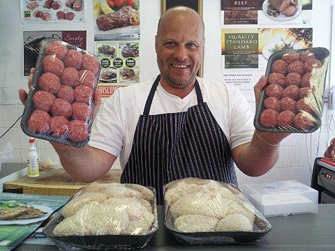 Phil the Butcher from J Par & Sons shows off his wares