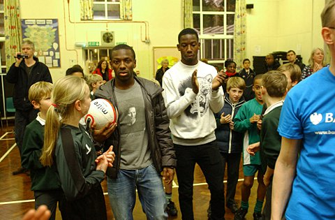Shaun Wright-Phillips and Bradley Wright-Phillips play football with West Wickham youngsters