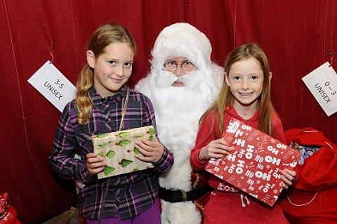 Grace Hearn, nine, and Ashley Hearn, seven, with Father Christmas
