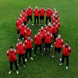Liverpool FC players form a red ribbon in support of World Aids Day (Liverpool FC/PA)