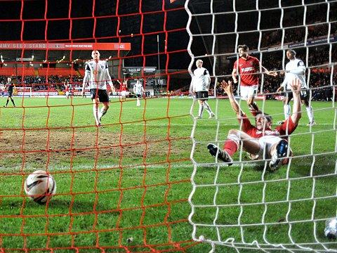 News Shopper: Yann Kermorgant scores Charlton's second last night. PICTURES BY KEITH GILLARD.