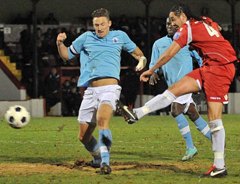 News Shopper: Scott Kinch blasts a shot past Blues skipper Rob Swaine to score Welling's third goal