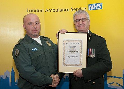 Danny Berry with Acting Chief Executive of the London Ambulance Service Martin Flaherty