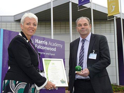 •	Principal Terrie Askew and Cllr John Fuller with the Green Apple Environmental Award and certificate.