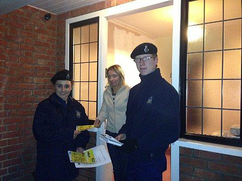 Cadets Mark Murphy and Shannon Murphy delivering anti-burglary material to West Wickham resident
